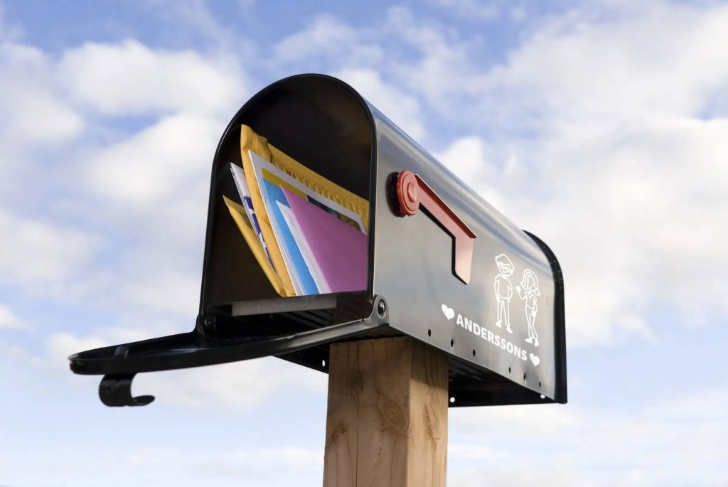 Traditional mailbox with a clear blue sky
